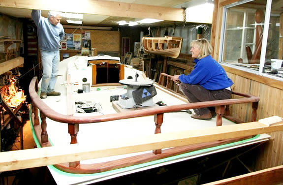 Cliff and Jody are getting ready for the evening shift, sanding and varnishing all the woodwork on deck